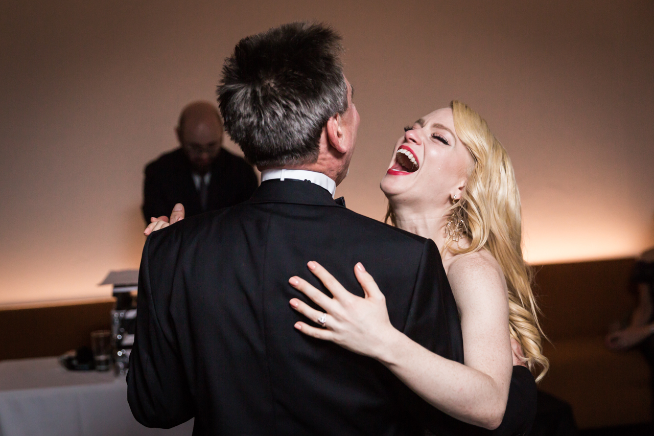 Bride laughing during father-daughter dance at a Central Park Conservatory Garden wedding