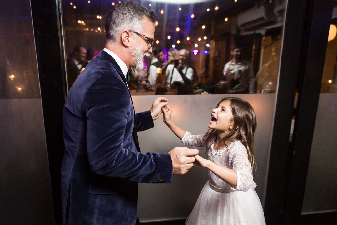 Father dancing with little girl at a Central Park Conservatory Garden wedding