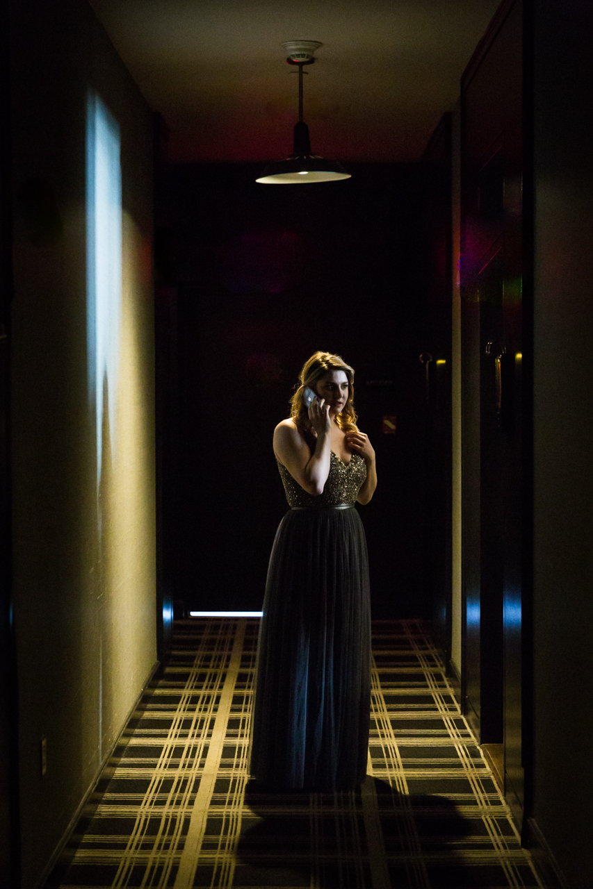 Bridesmaid in a dark hallway at a Central Park Conservatory Garden wedding