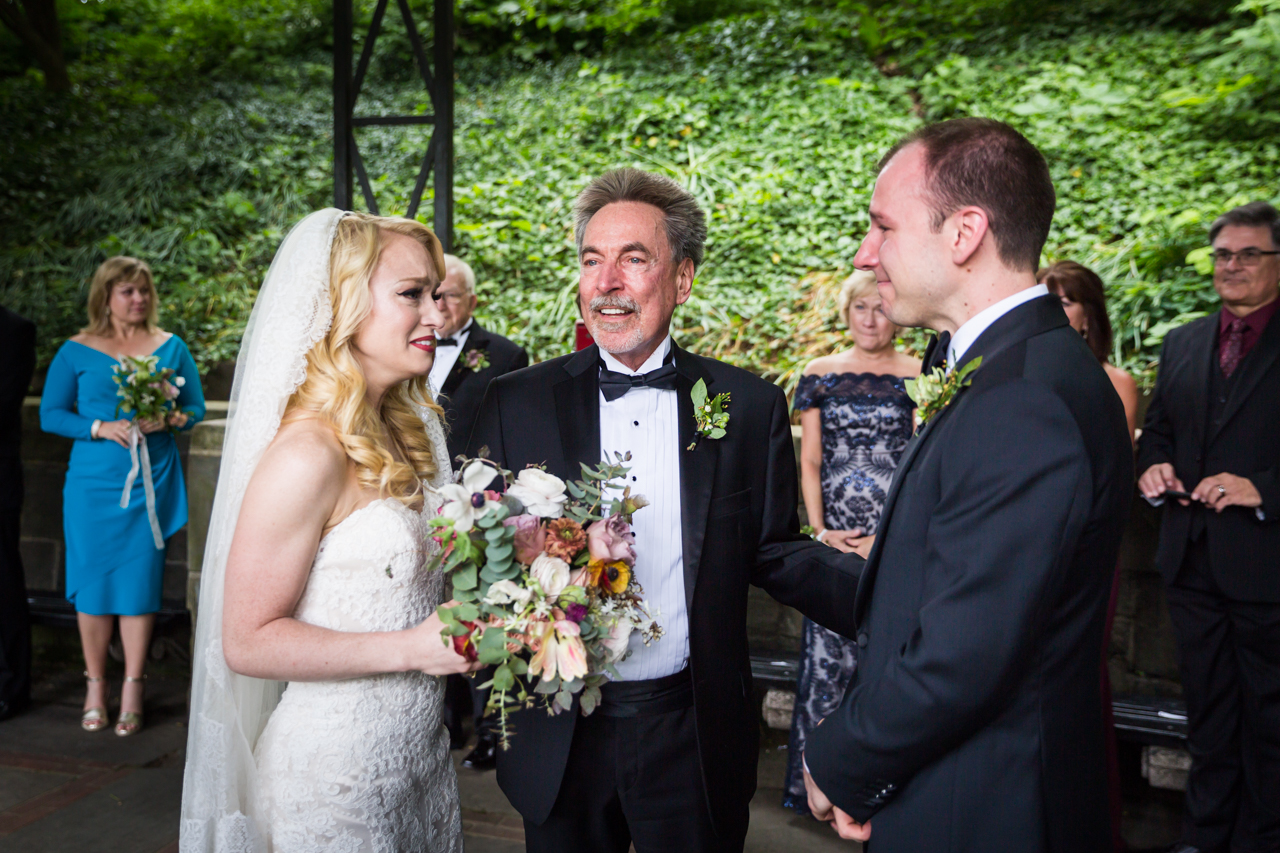 Father giving away bride at a Central Park Conservatory Garden wedding