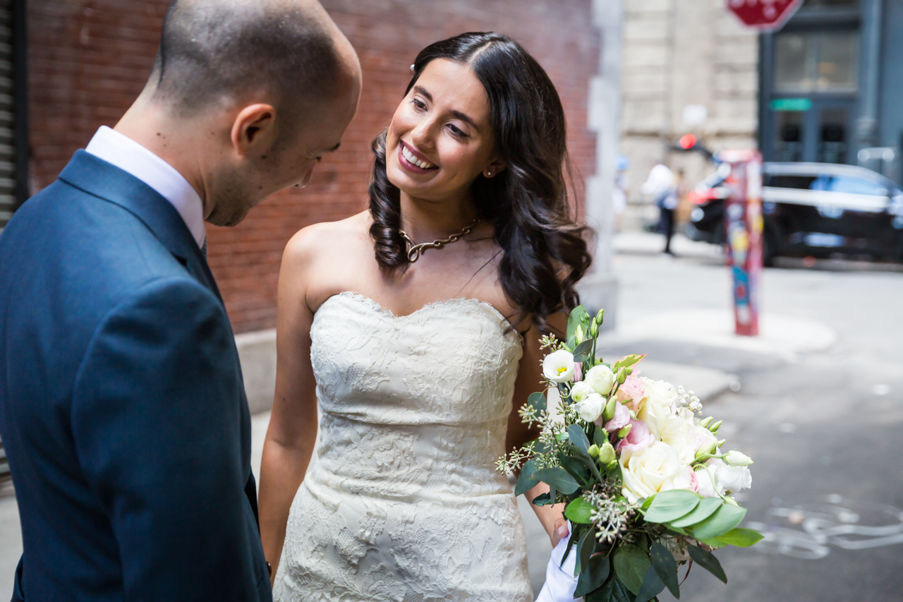 Bride and groom looking at each other for an article on non-floral centerpiece ideas
