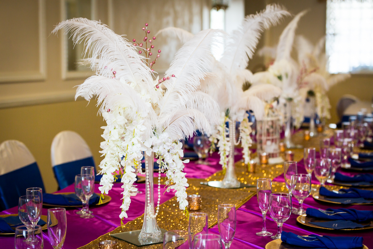 White feather centerpieces for an article on non-floral centerpiece ideas
