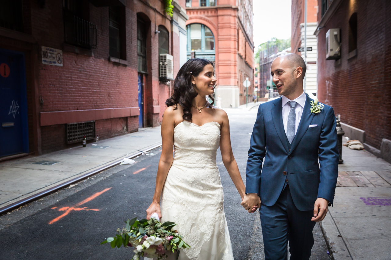 Bride and groom walking hand-in-hand for an article on non-floral centerpiece ideas