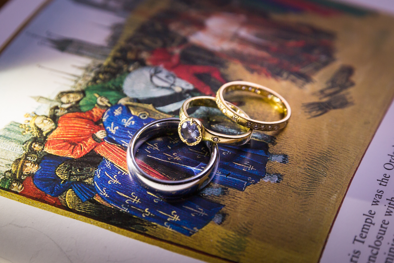 Wedding rings on Renaissance book for an article on non-floral centerpiece ideas