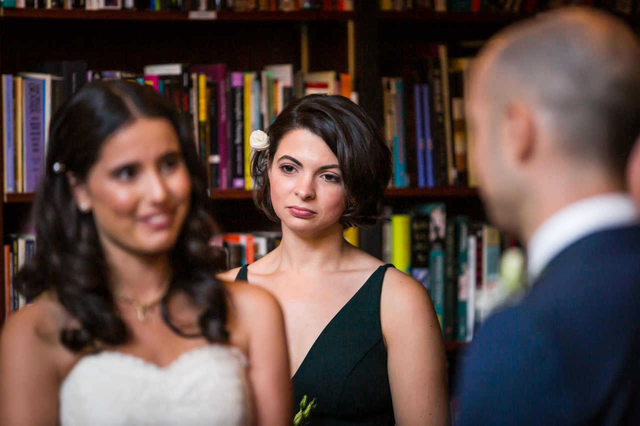 Bridesmaid watching couple for an article on non-floral centerpiece ideas
