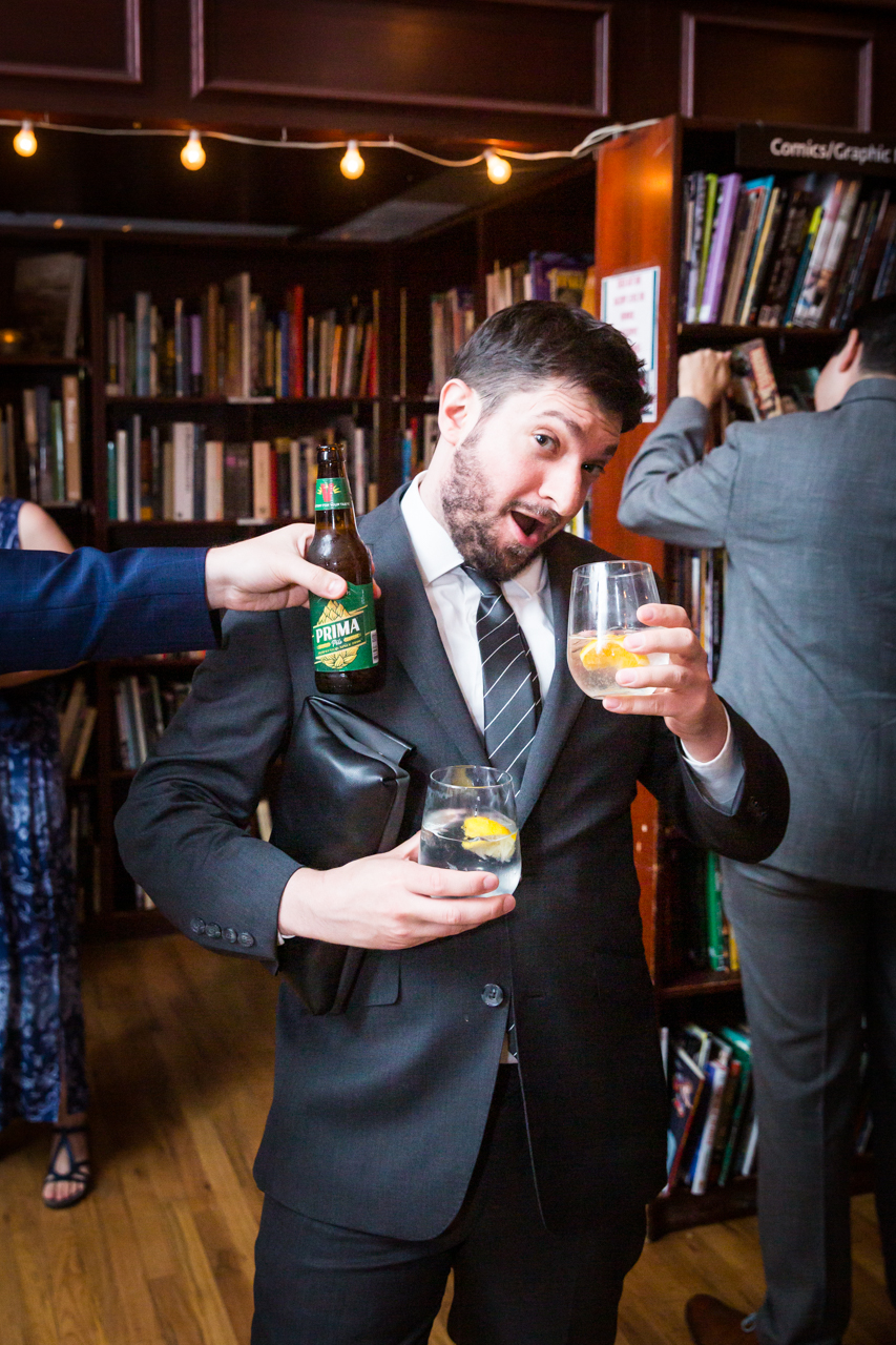 Guest enjoying drinks at reception for an article on non-floral centerpiece ideas
