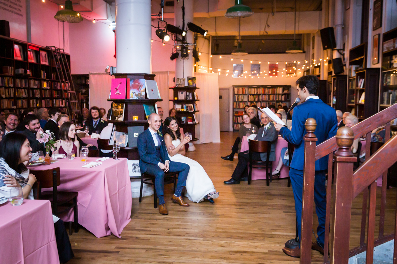 Bride and groom listening to speech for an article on non-floral centerpiece ideas