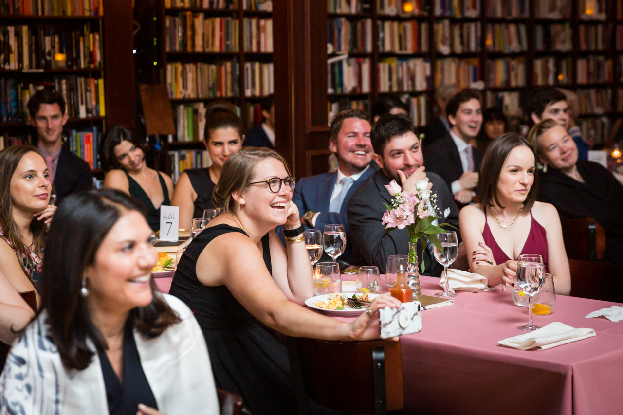 Guests listening to toasts for an article on non-floral centerpiece ideas