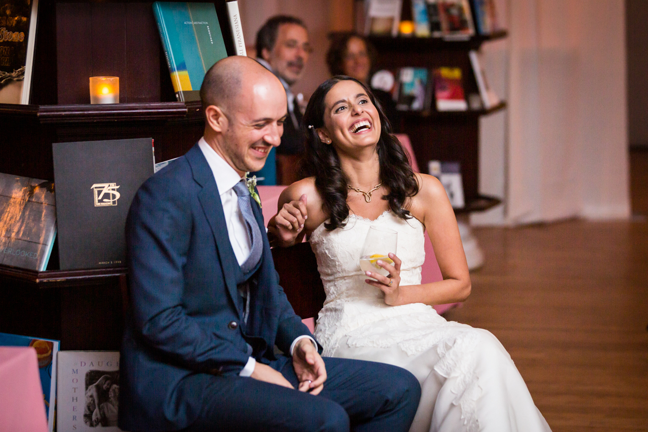 Bride and groom laughing at toasts for an article on non-floral centerpiece ideas