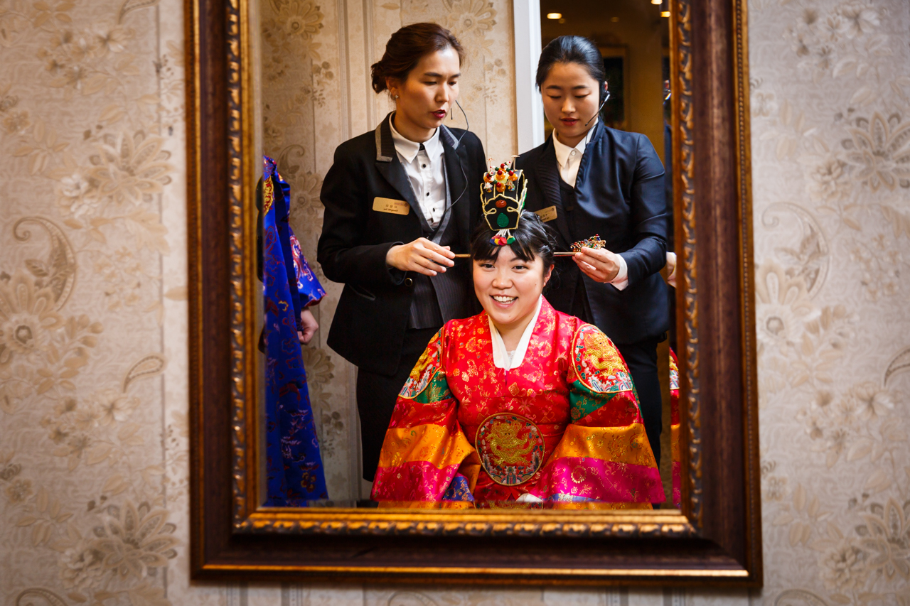 Bride and two attendants during traditional Korean pyebaek ceremony