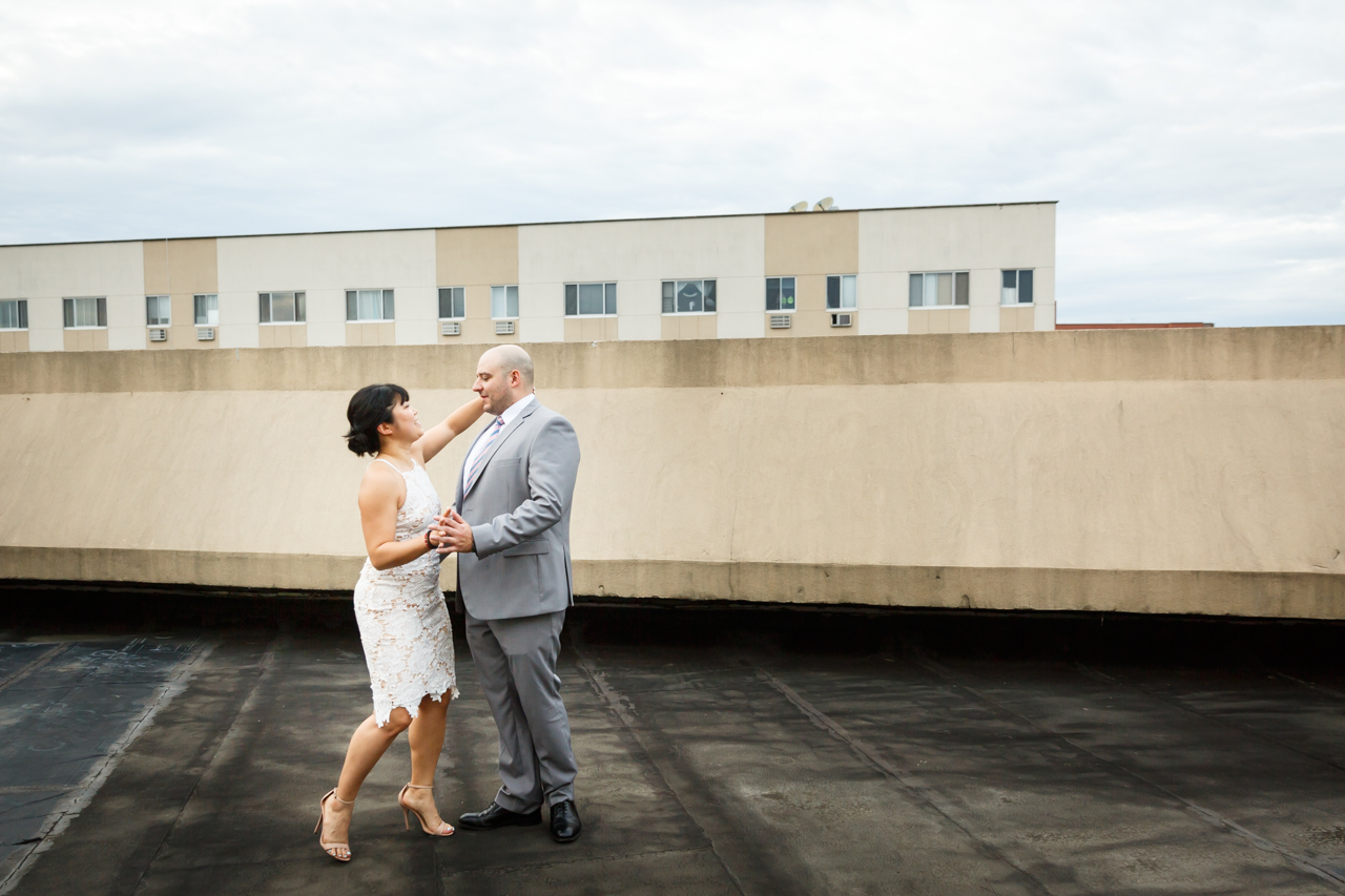 Bride and groom dancing on Dae Dong Manor roof