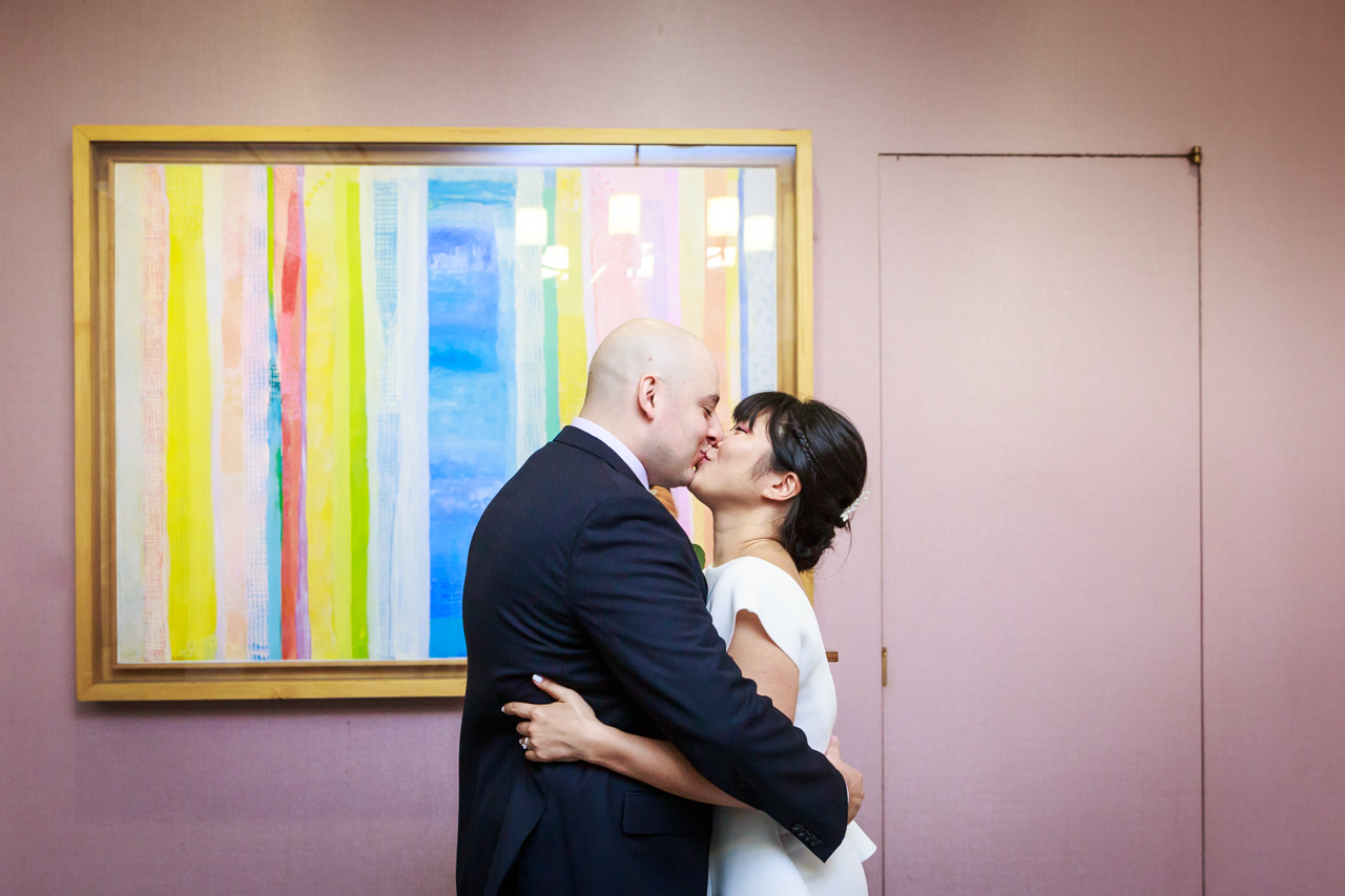 Bride and groom kissing at NYC City Hall wedding