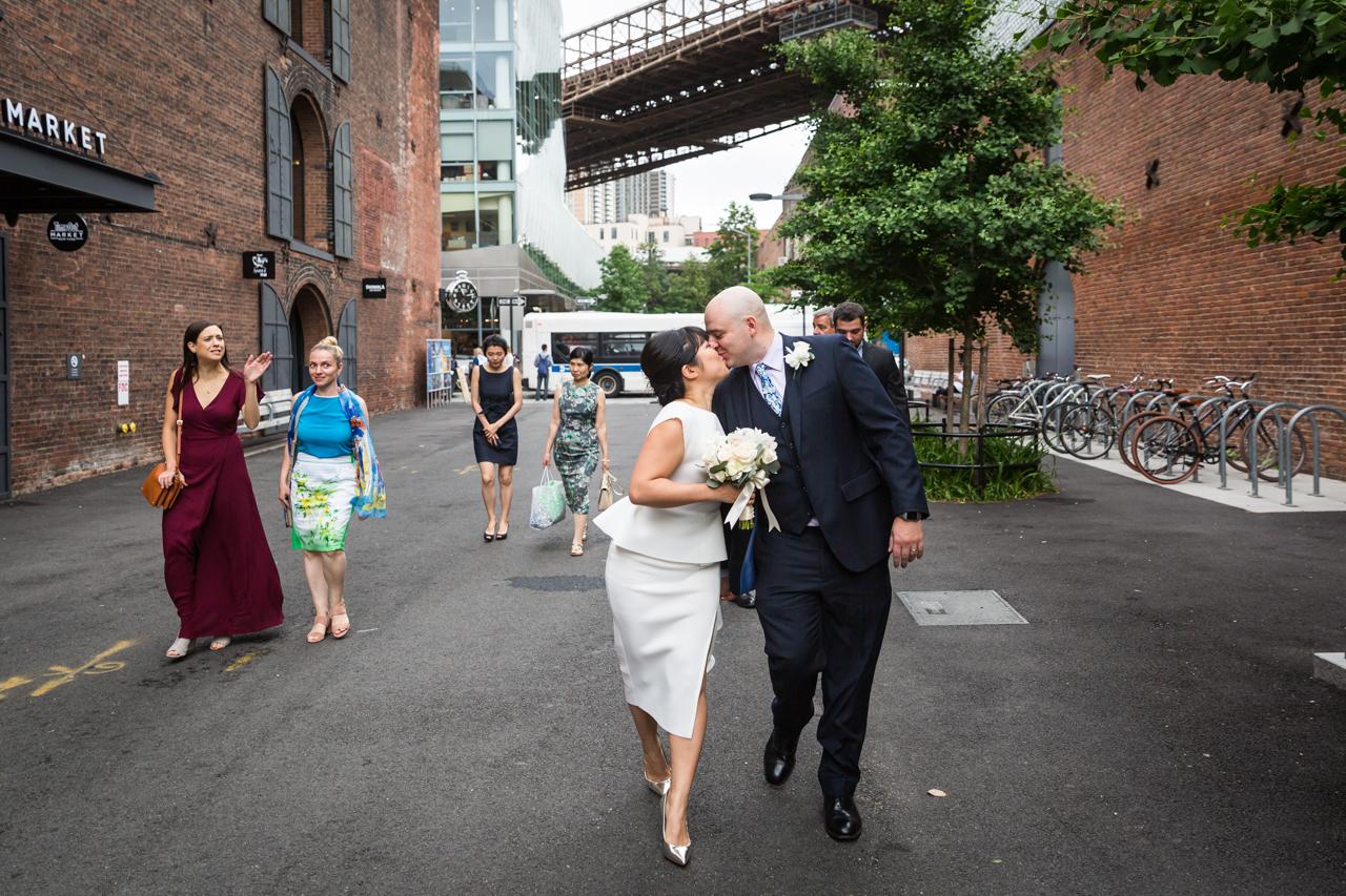 Bride and groom kissing in Brooklyn Bridge Park