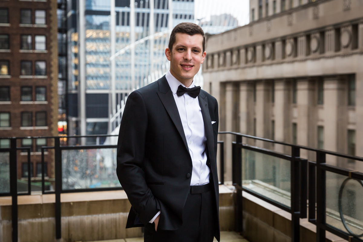 Portrait of groom with hands in pocket on terrace of Four Seasons Hotel New York Downtown