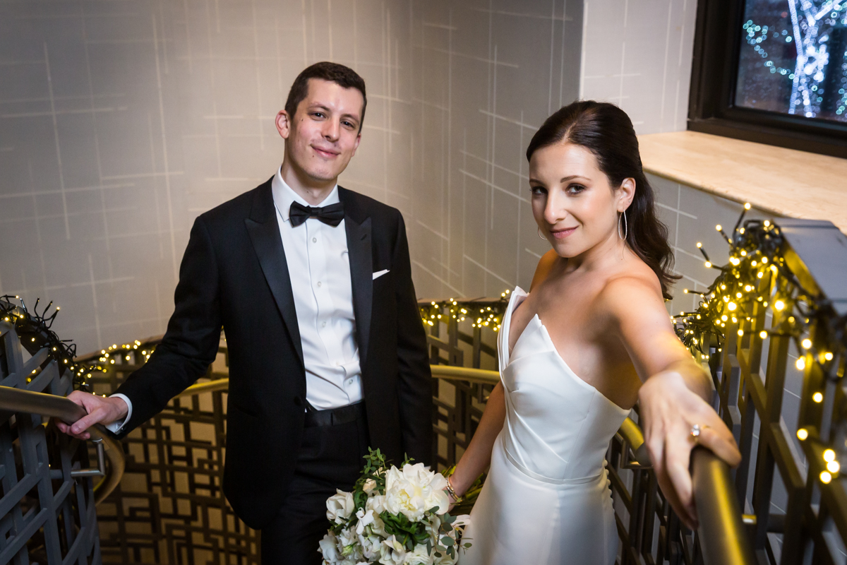 Bride and groom looking fierce on a staircase