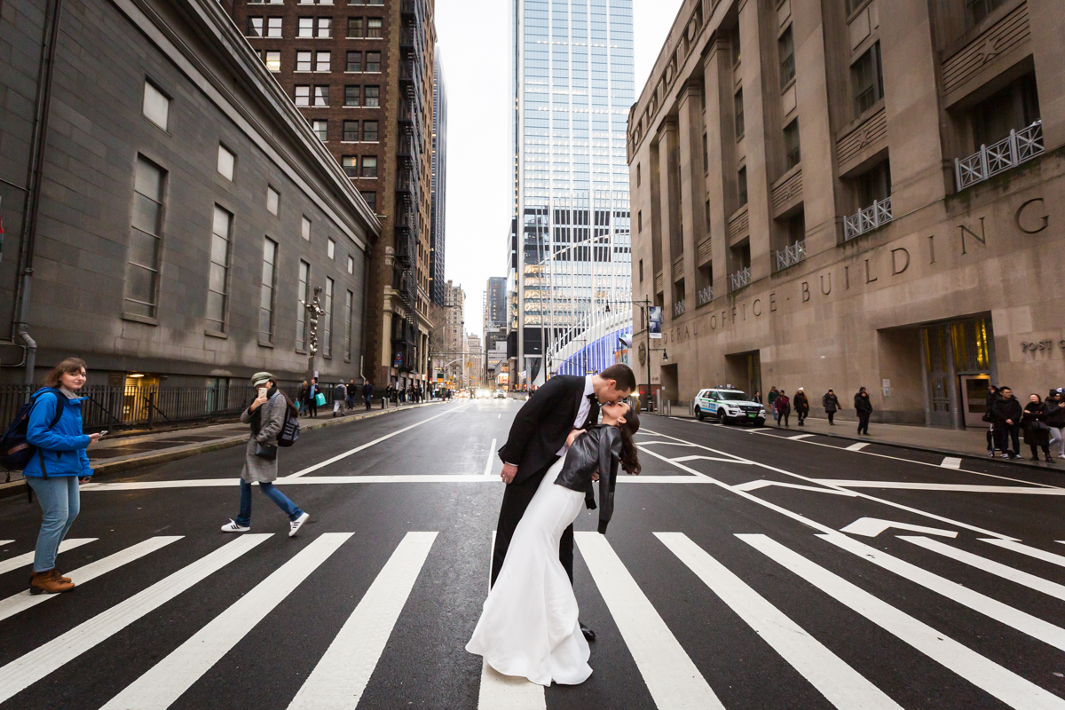 Bride and groom kissing in a NYC crosswalk