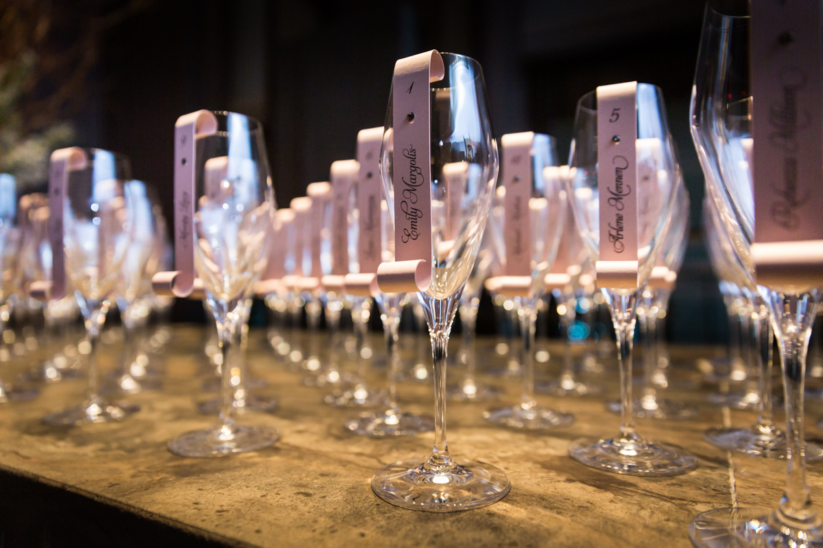 Champagne flutes used to display guest escort cards