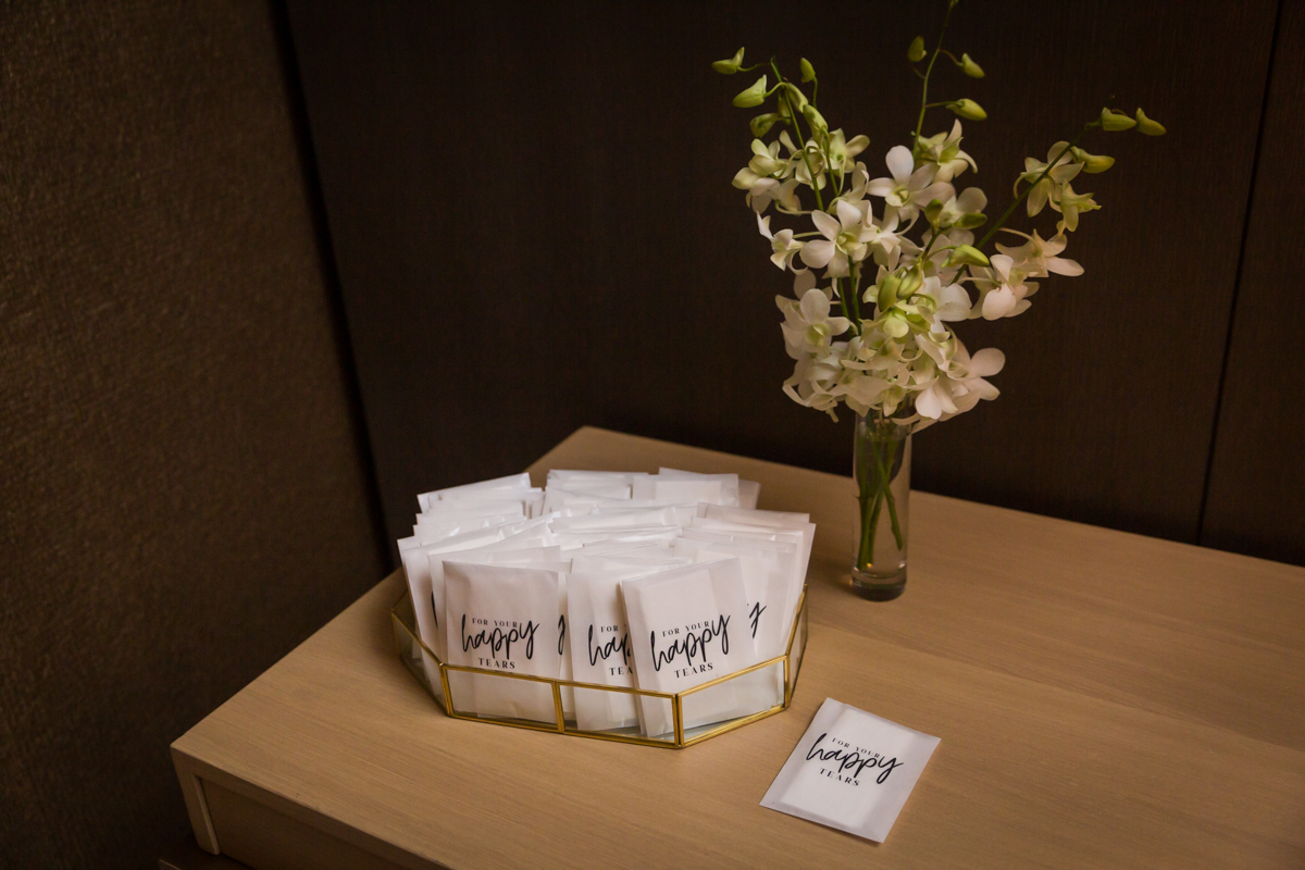 Cute tissue packets provided to guests at a Four Seasons Hotel New York Downtown wedding