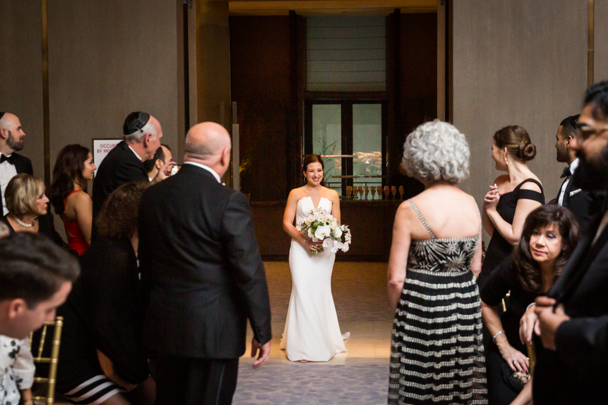 Bride about to walk down the aisle at a Four Seasons Hotel New York Downtown wedding