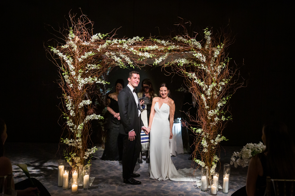 Bride and groom during a Four Seasons Hotel New York Downtown wedding ceremony