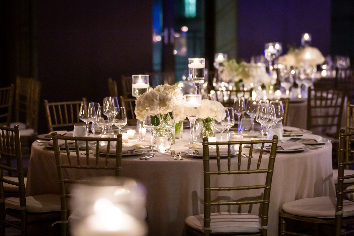 White flower centerpieces at a Four Seasons Hotel New York Downtown wedding