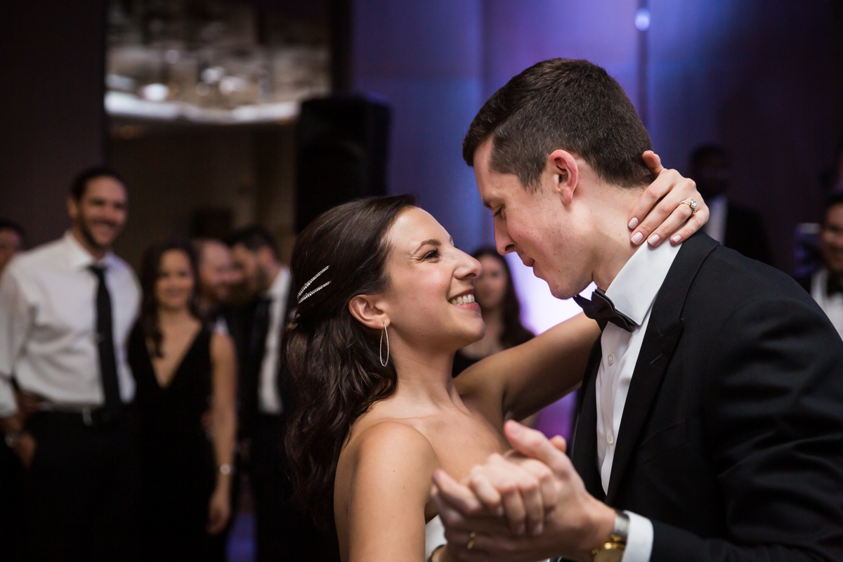 Bride and groom dancing during first dance at a Four Seasons Hotel New York Downtown wedding