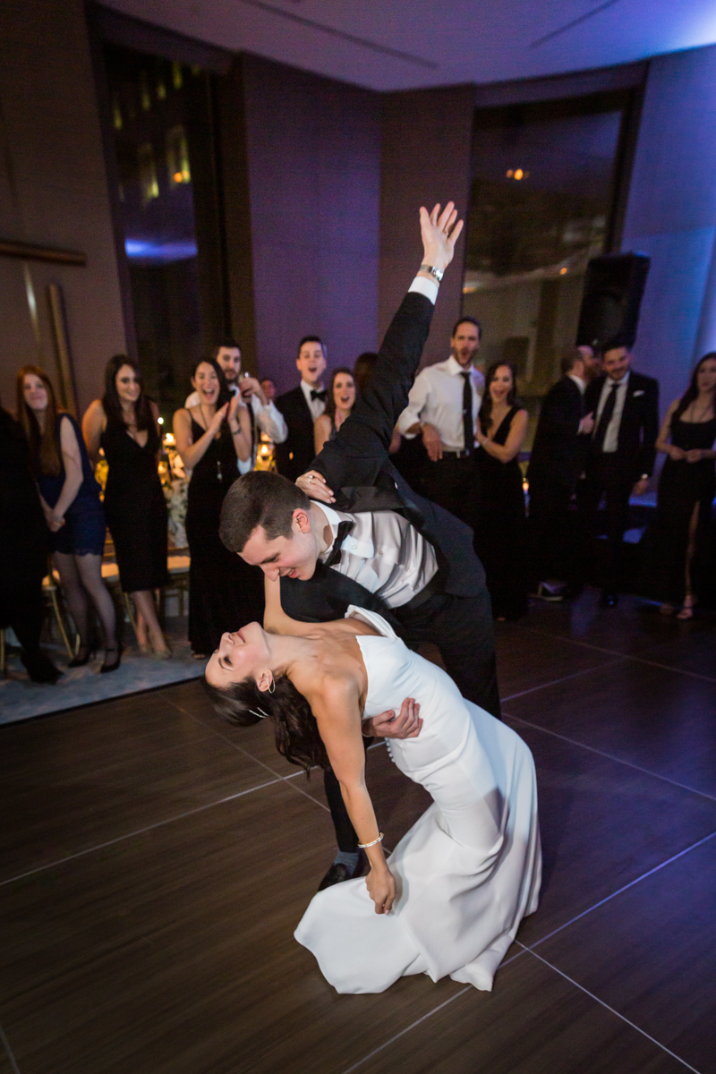 Groom dipping bride during first dance at a Four Seasons Hotel New York Downtown wedding