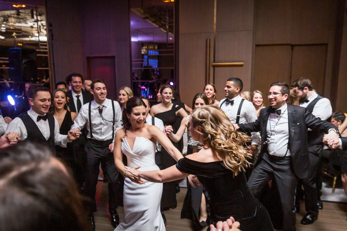 Bride and guests dancing during the hora at a Four Seasons Hotel New York Downtown wedding
