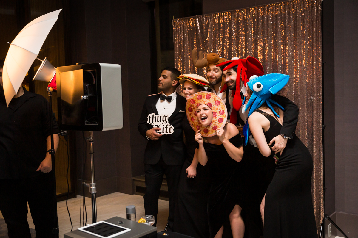 Guests clowning around at photo booth during Four Seasons Hotel New York Downtown wedding