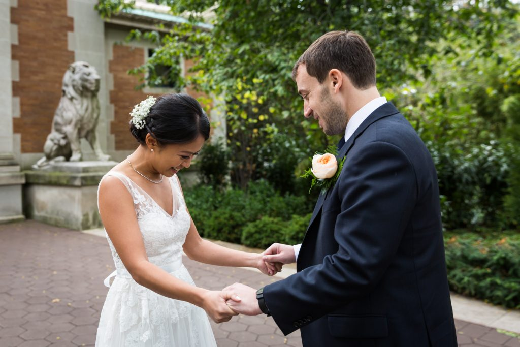 Bronx Zoo wedding photos of bride and groom during first look