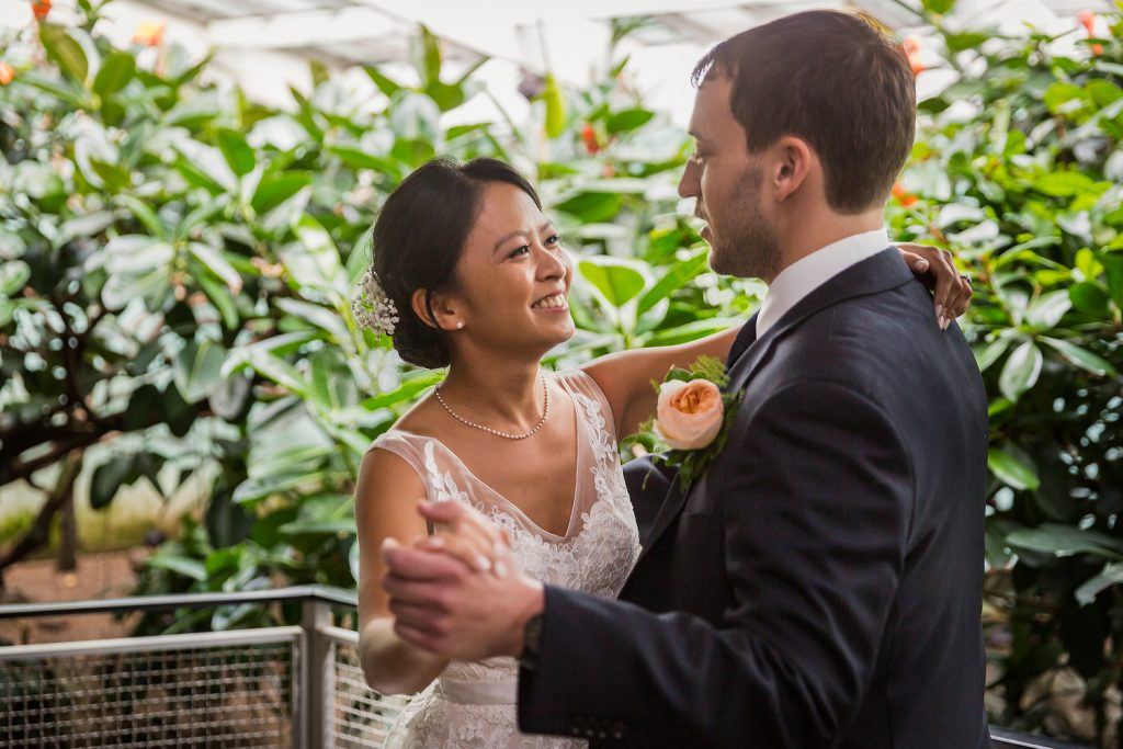 Bride and groom dancing in the Aquatic Bird House for Bronx Zoo wedding photos