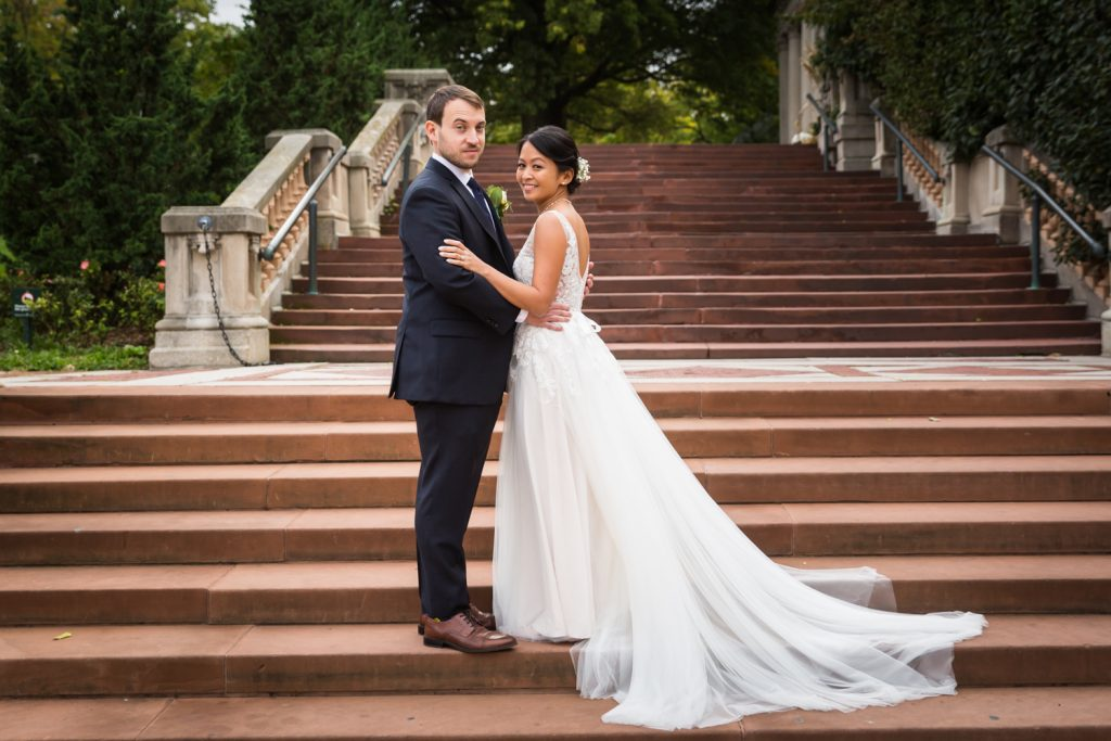 Bronx Zoo wedding photos of bride and groom on staircase
