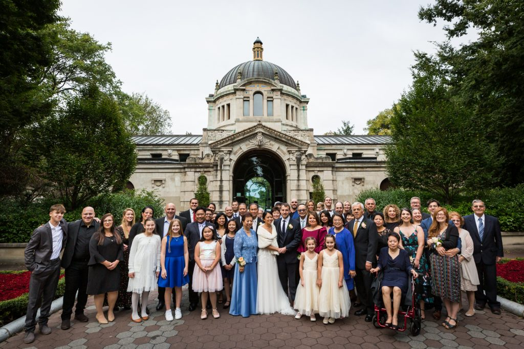 Large family portrait behind Zoo Administration Building for Bronx Zoo wedding photos