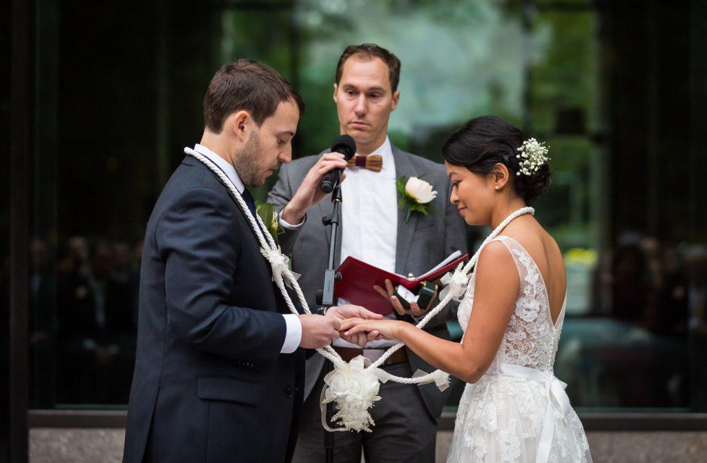 Filipino knot tying ceremony during Bronx Zoo wedding