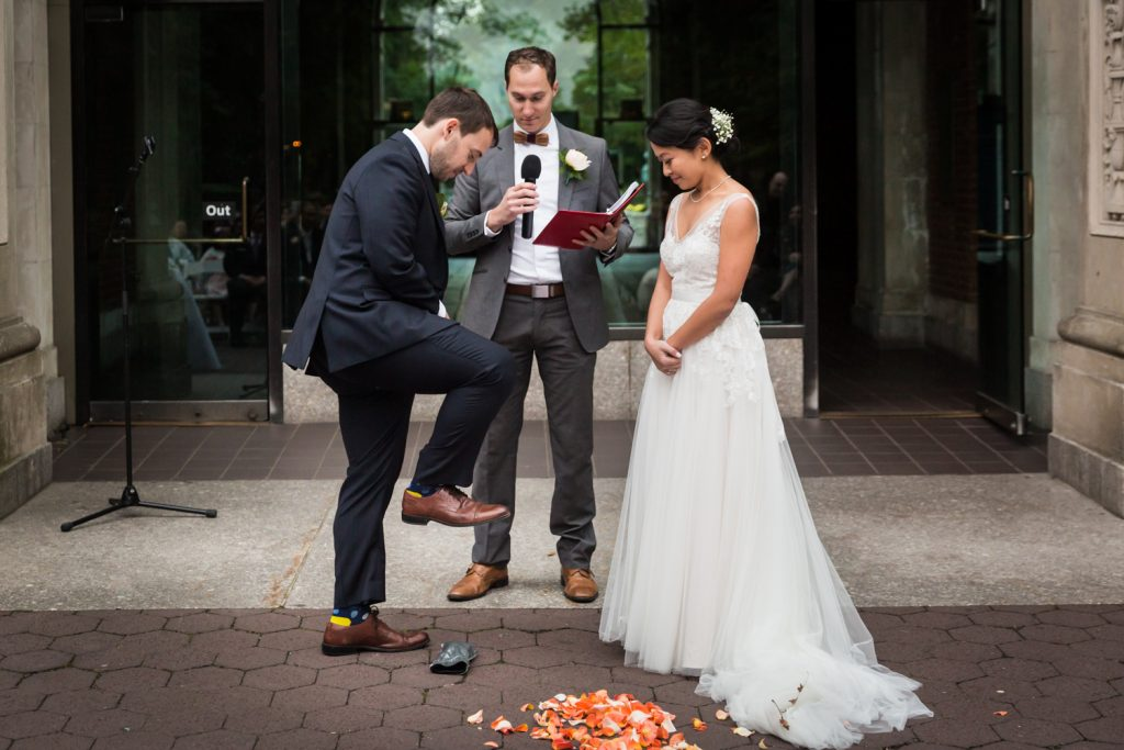 Groom about to smash glass during Bronx Zoo wedding ceremony