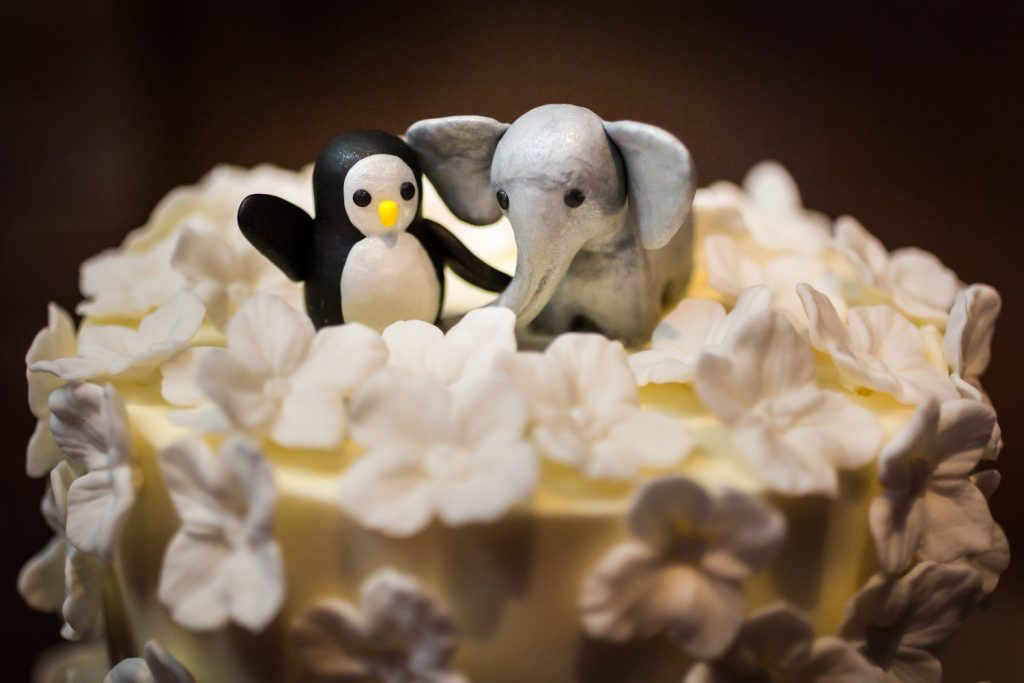 Penguin and elephant wedding cake toppers at Bronx Zoo wedding