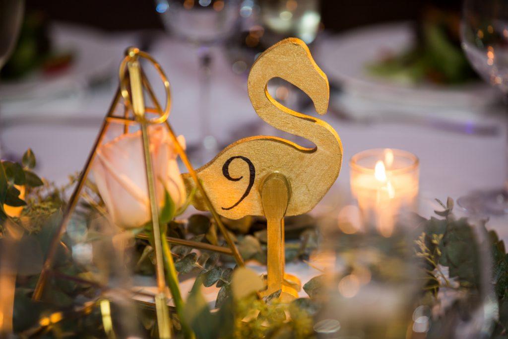 Wooden flamingo table number at Bronx Zoo wedding