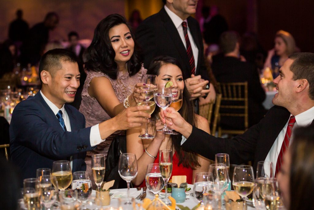 Guests toasting with glasses at Bronx Zoo wedding