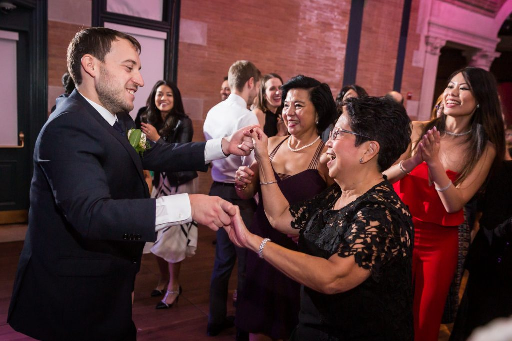 Groom dancing with mother-in-law at Bronx Zoo wedding reception