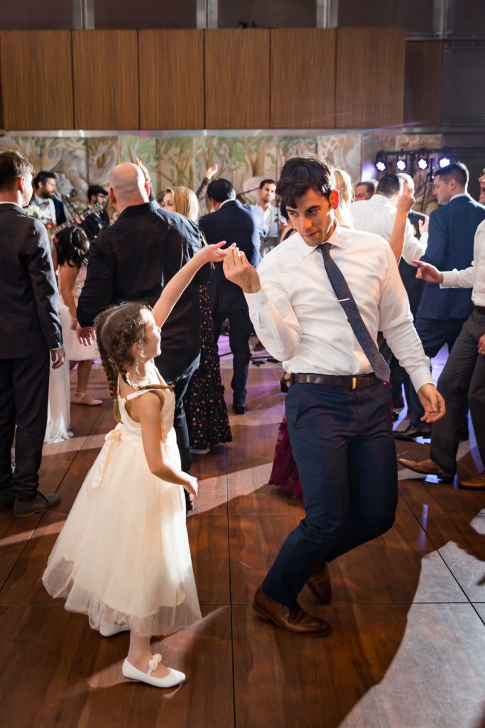 Man dancing with little girl at Bronx Zoo wedding reception