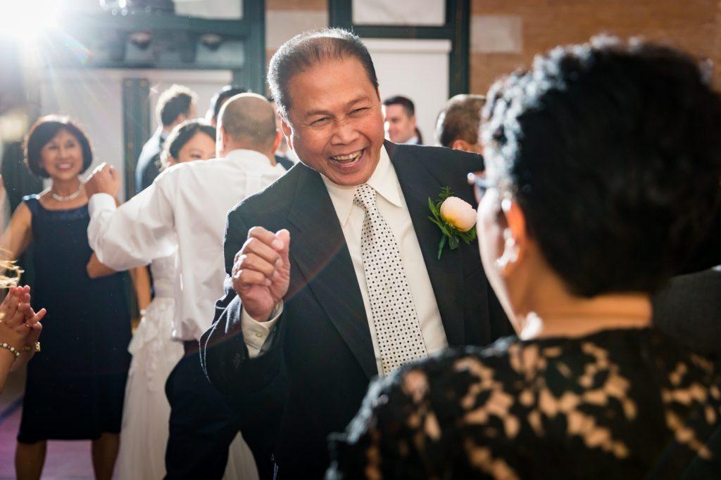 Man dancing at Bronx Zoo wedding reception