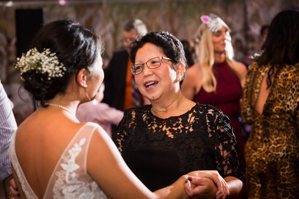 Woman greeting bride at Bronx Zoo wedding