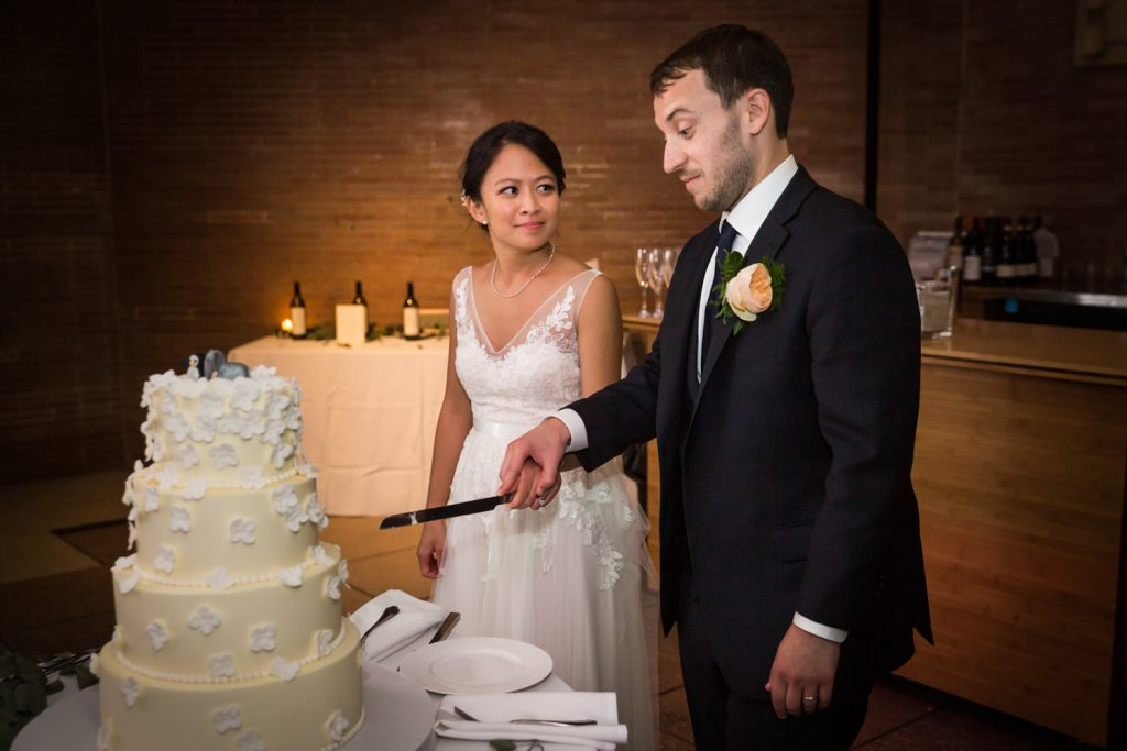 Bride and groom cutting cake at Bronx Zoo wedding