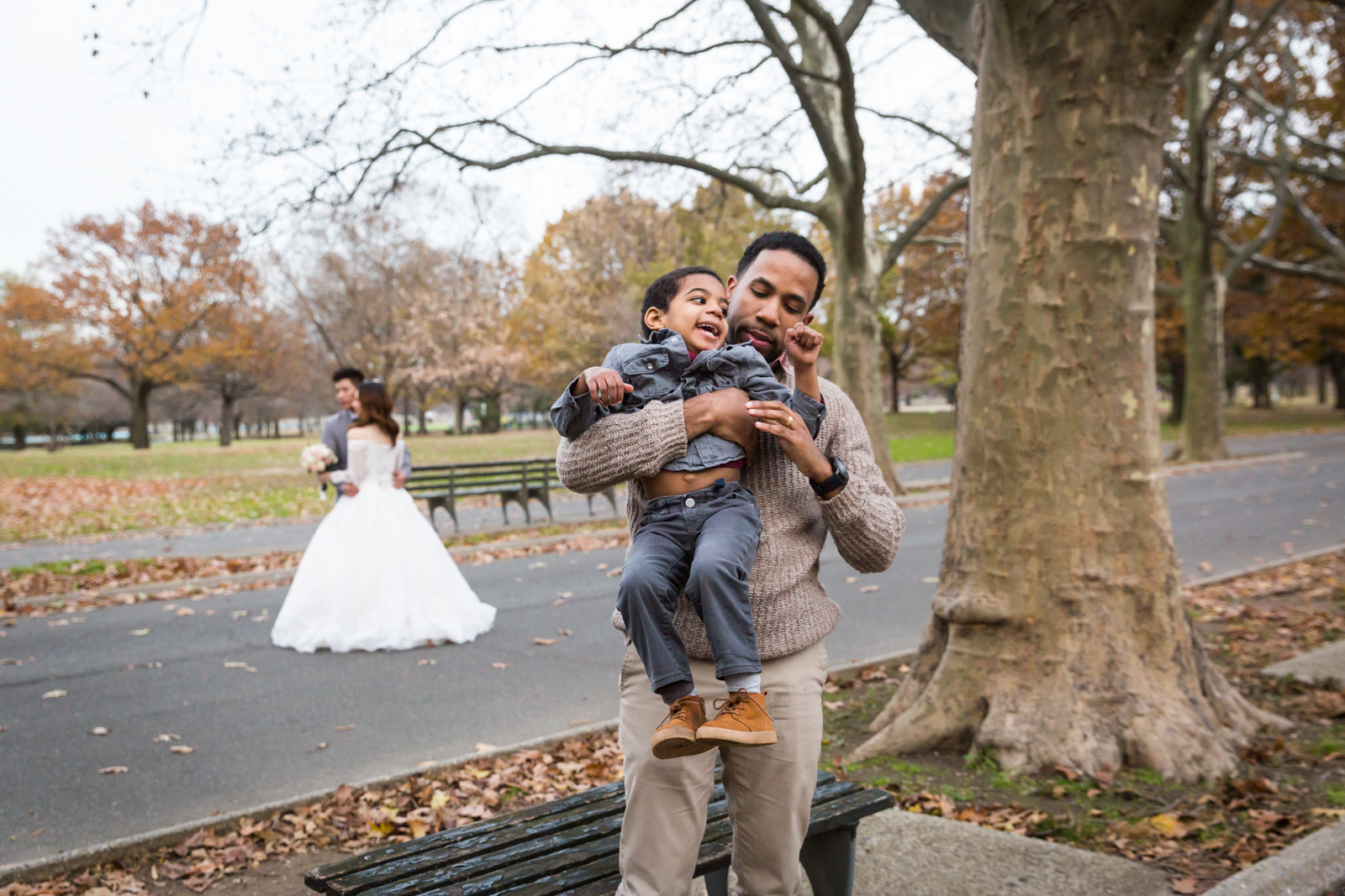 Flushing Meadows Corona Park family portrait of father holding son