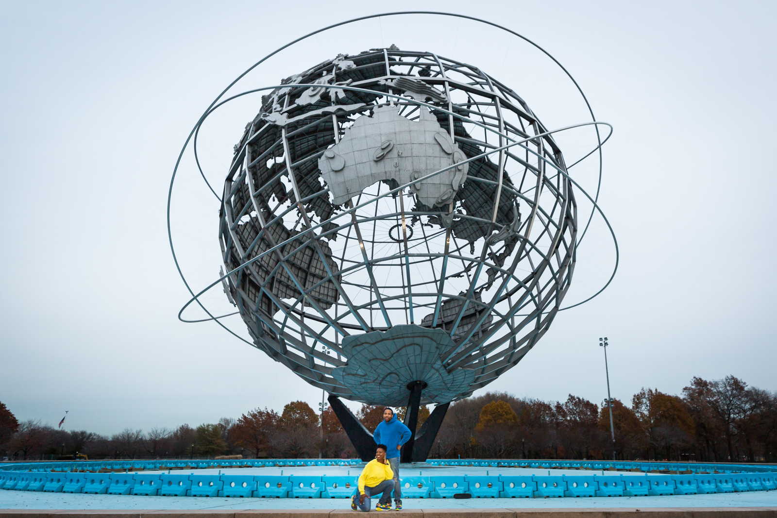 Flushing Meadows Corona Park family portrait of parents in front of Unisphere