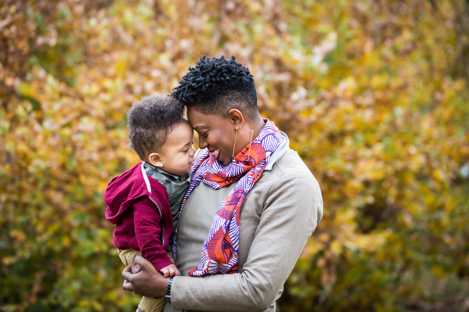 Flushing Meadows Corona Park family portrait of mother and little boy touching foreheads