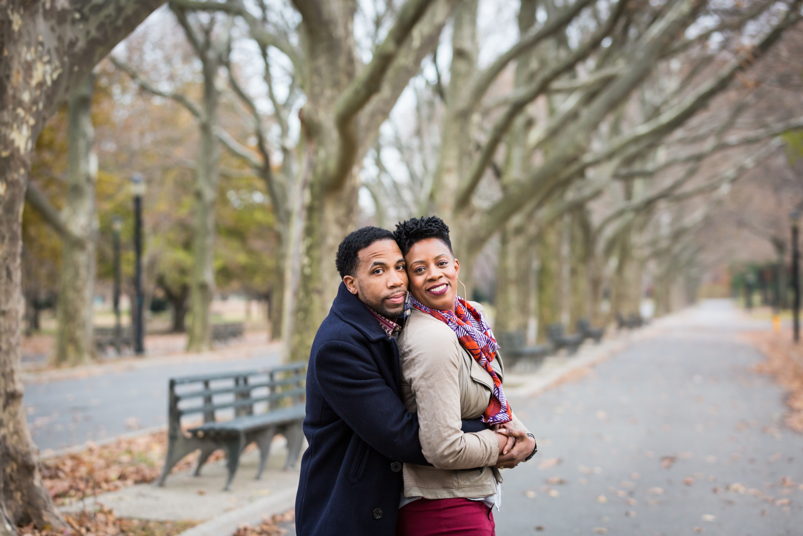 Flushing Meadows Corona Park family portrait of parents hugging