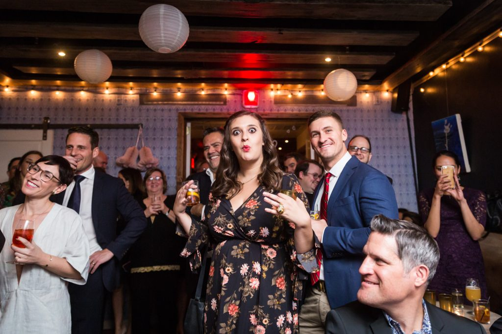 Woman making funny face at wedding reception