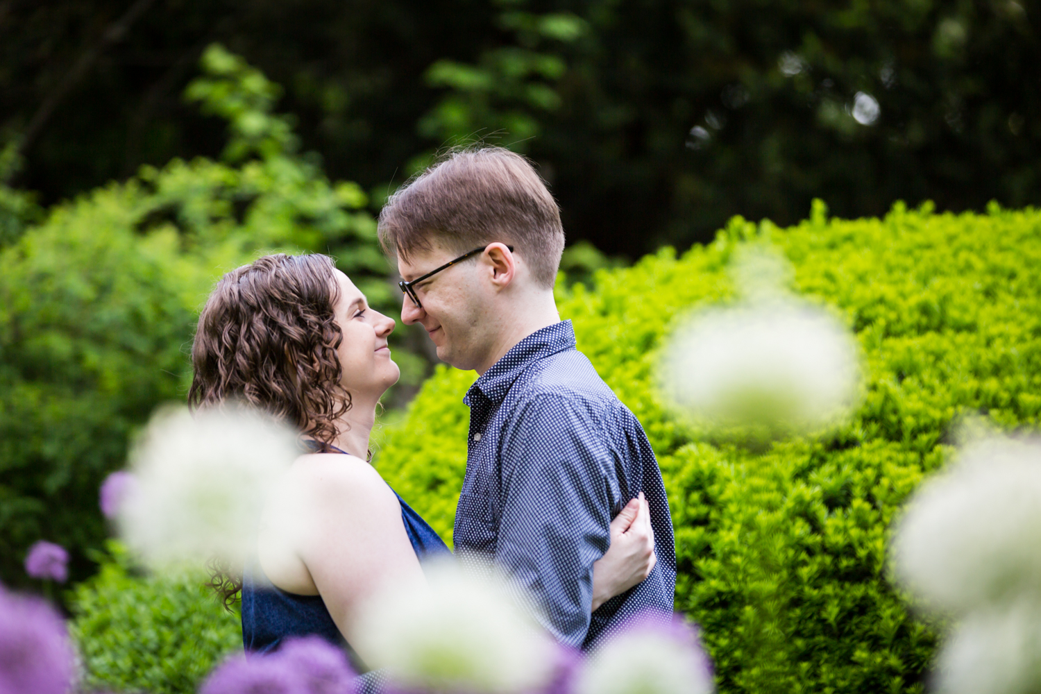 View through flowers of man and woman looking at each other