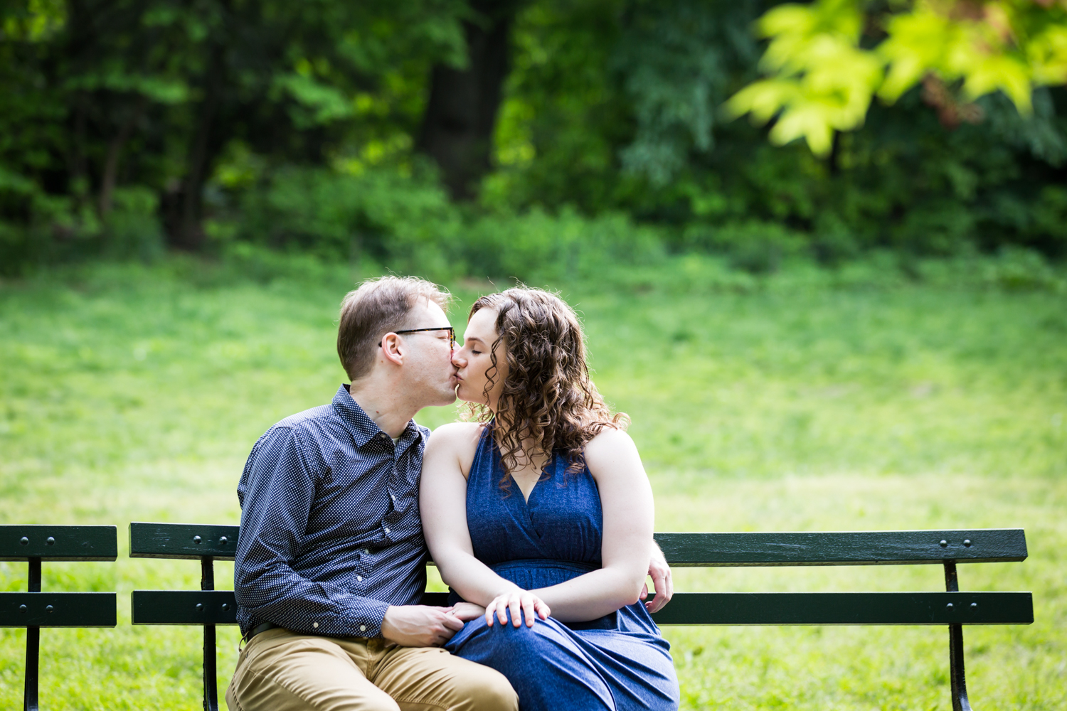 Man and woman kissing on bench in Central Park